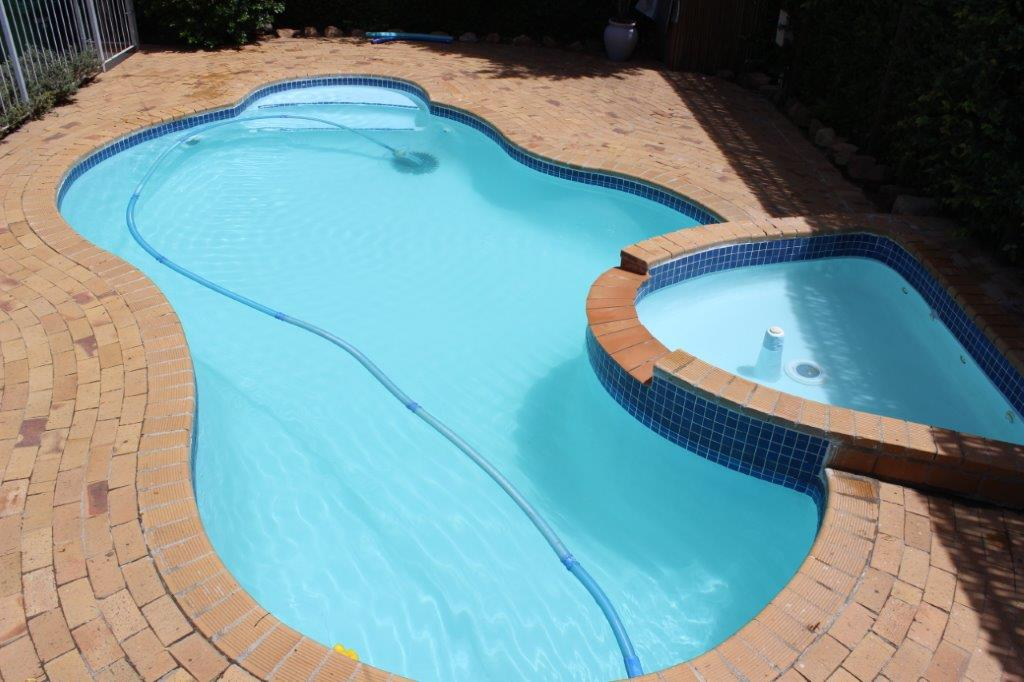 Renovated fibreglass lining pool in Newlands with clear and sparkling water