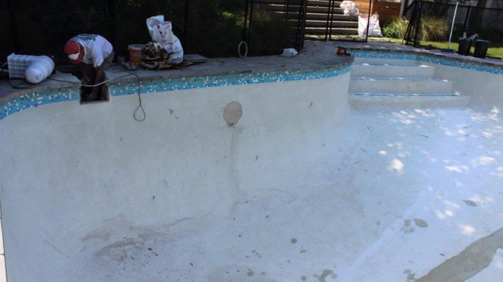 Constantia Pool workers-are-preparing-renovation-of-pool-new-fibreglass-lining-new-pool-light-relacing-tiles-with-ceramin-mosaic-tiles