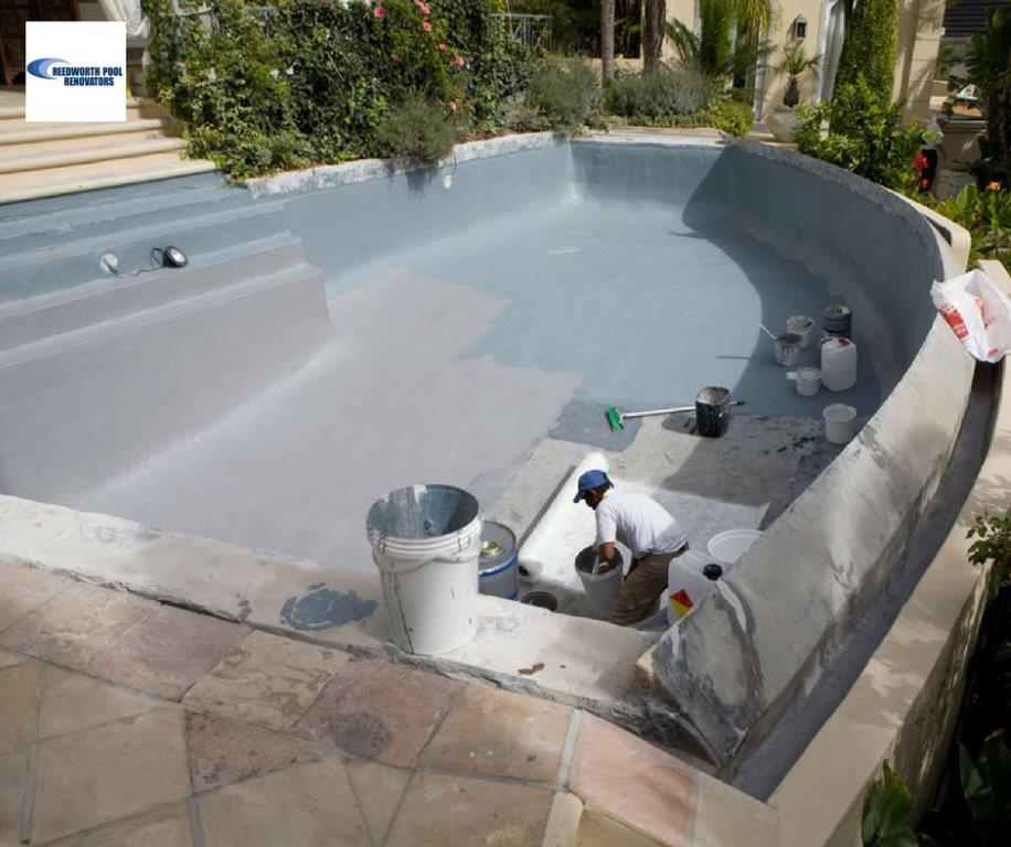 Inverness renovation-specialist-applying-new-fibreglass-lining-to-an-infinity-pool-grey-charcoal-in-pigment