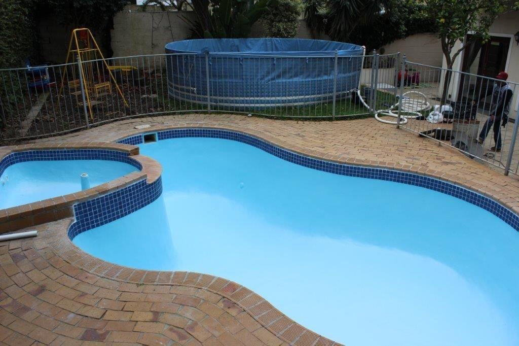 Pool-renovation-porta-pool-in-the-background-which-is-used-to-store-pool-water-during-construction