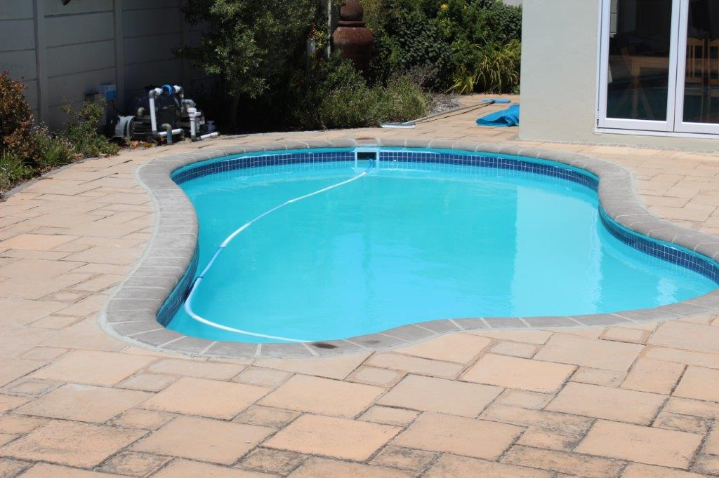 pplication of a light blue top finishing coat to the pool