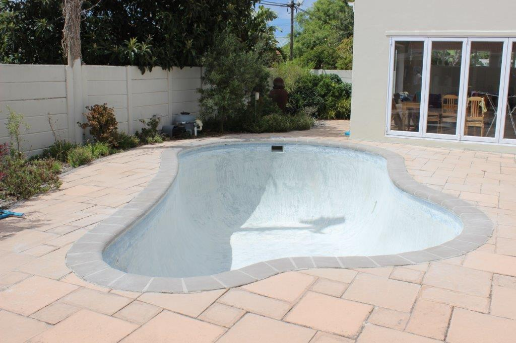 Repair of surface cracks and holes in the lining of teh pool.