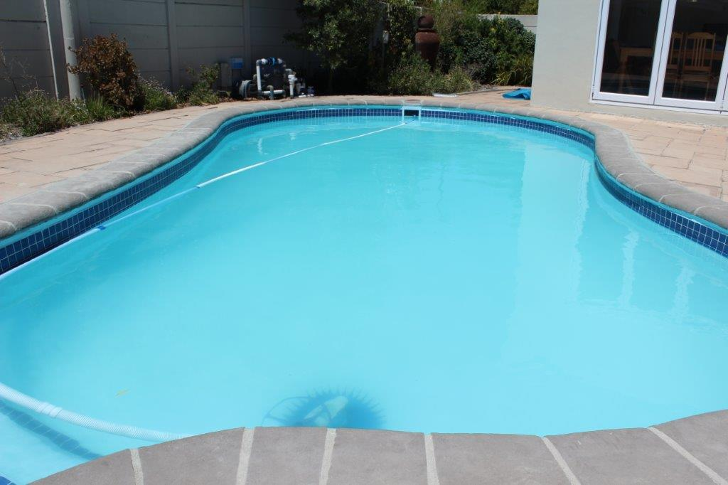 Application of a light blue top finishing coat to the pool.