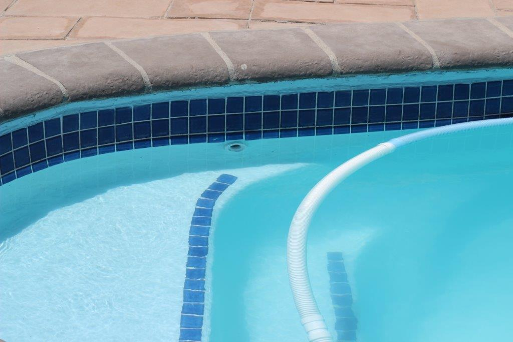 Application of non-slip surfaces on the step areas of the pool.