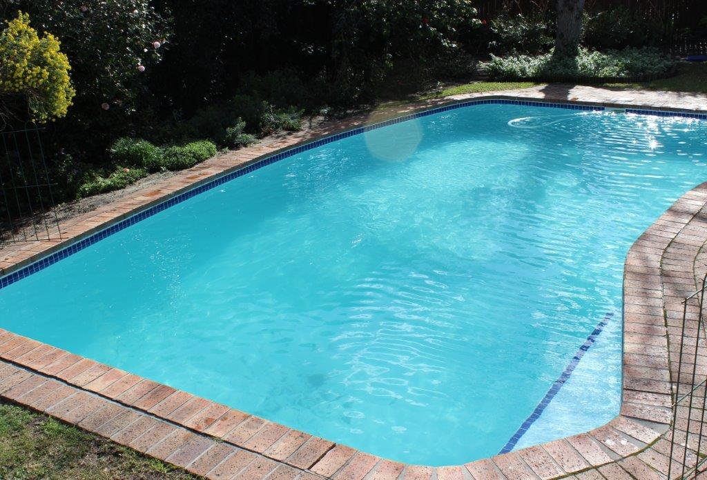 Bergvliet, New fibreglass lining pool tiles applied at top of pool on steps martini seat