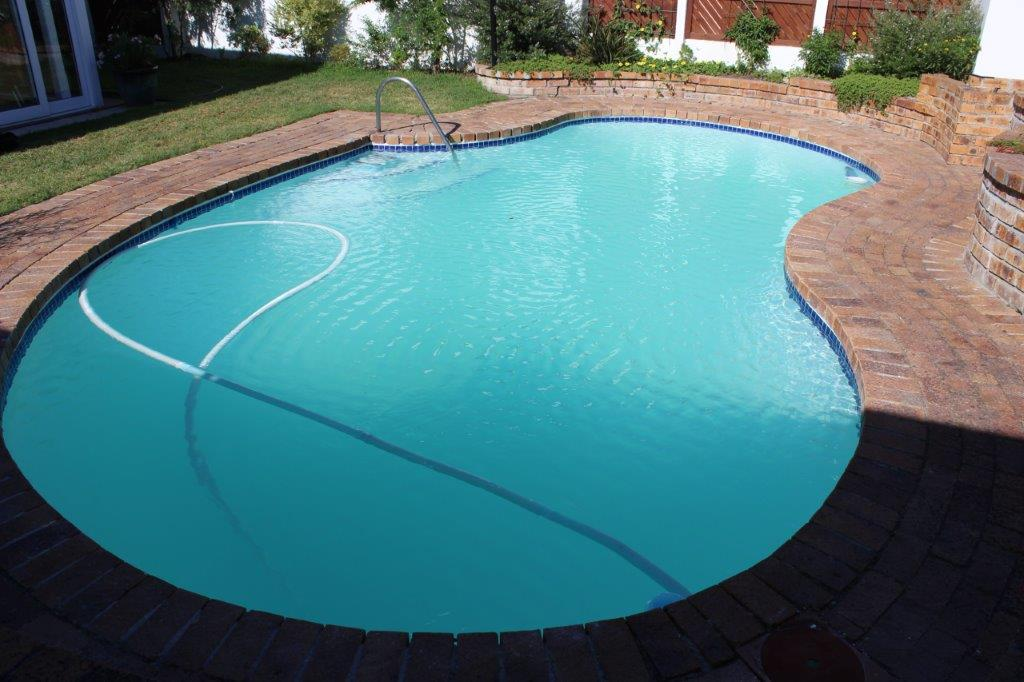This pool had a worn fibreglass lining, faded tissue mosaics and the weir had subsided.