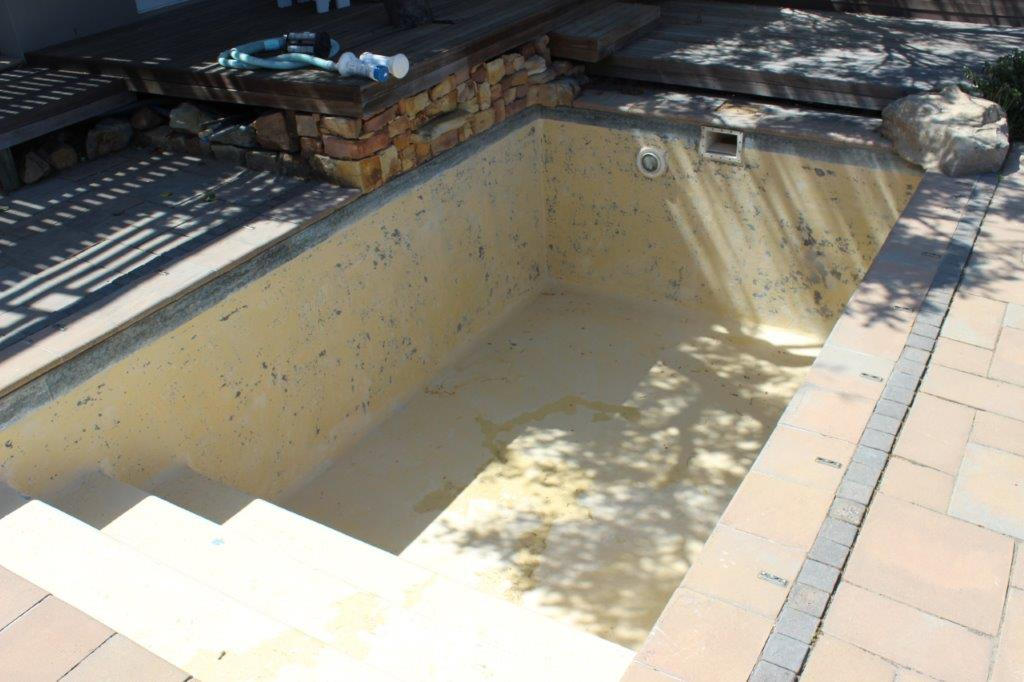 Reedworth Pool Renovations, Noordhoek Swimming Pool Sanding down and preparation of the pool surface for pale grey fibreglass & Mosaic Tiles
