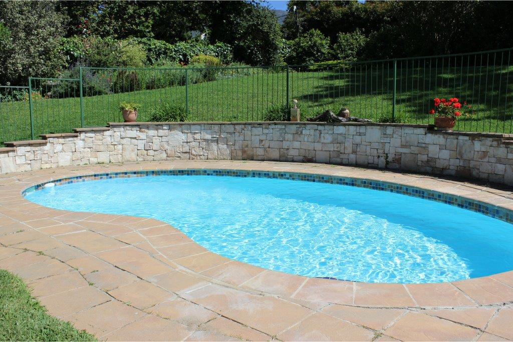 Constantia small pools, application of ceramic mosaic pool tiles at the step entry area of the pool