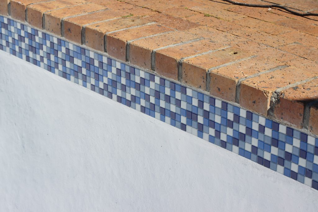 Noordhoek New glass mosaic pool tiles around the circumference of the pool