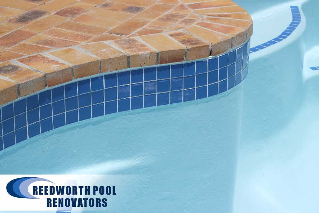 Small Pools, Claremont Renovation Application of ceramic mosaic pool tiles around circumference pool